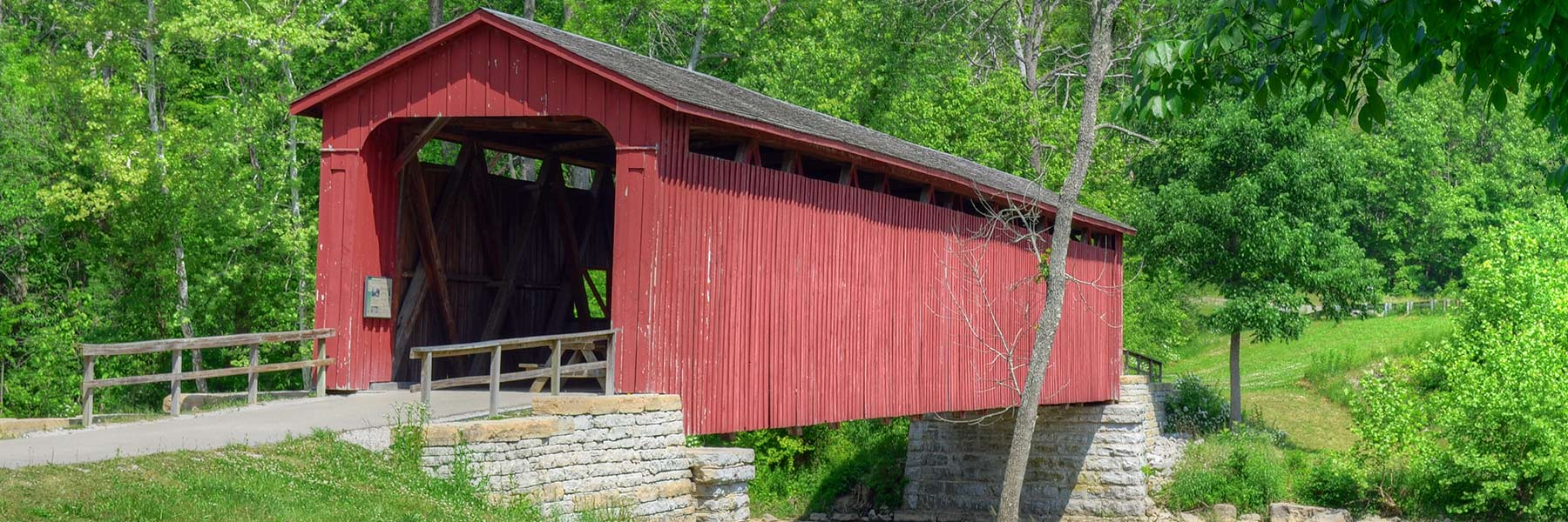 Covered bridge over Cataract Falls, a waterfall located in northern Owen County.