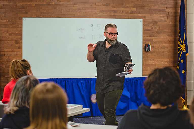 IU faculty member reads poetry to a group of high school students in Brown County, Indiana.