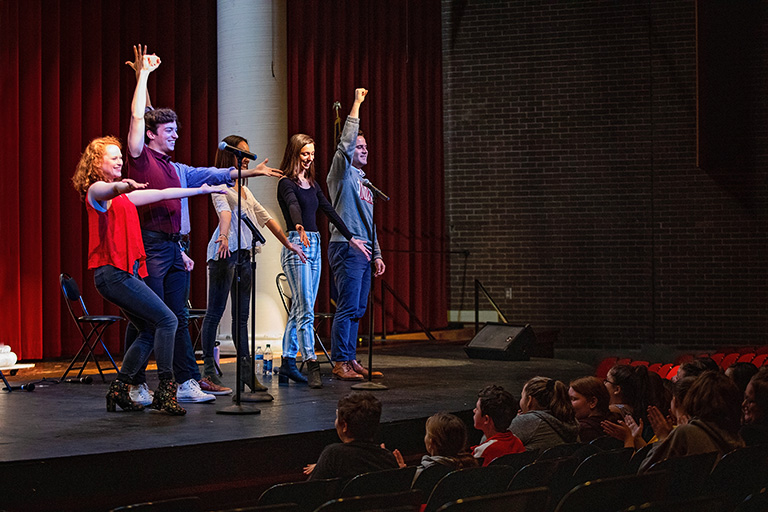 IU Theatre's cabaret group performs for students in Salem, Indiana.