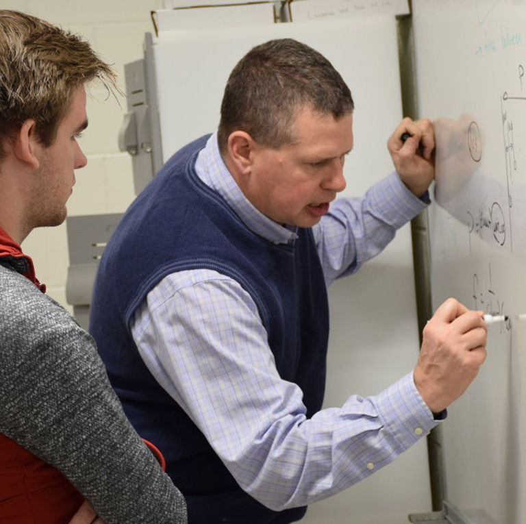 IU Faculty member, Bryce Himebaugh, discusses plans with a student for the Hoosier National Forest Dark Sky initiative.