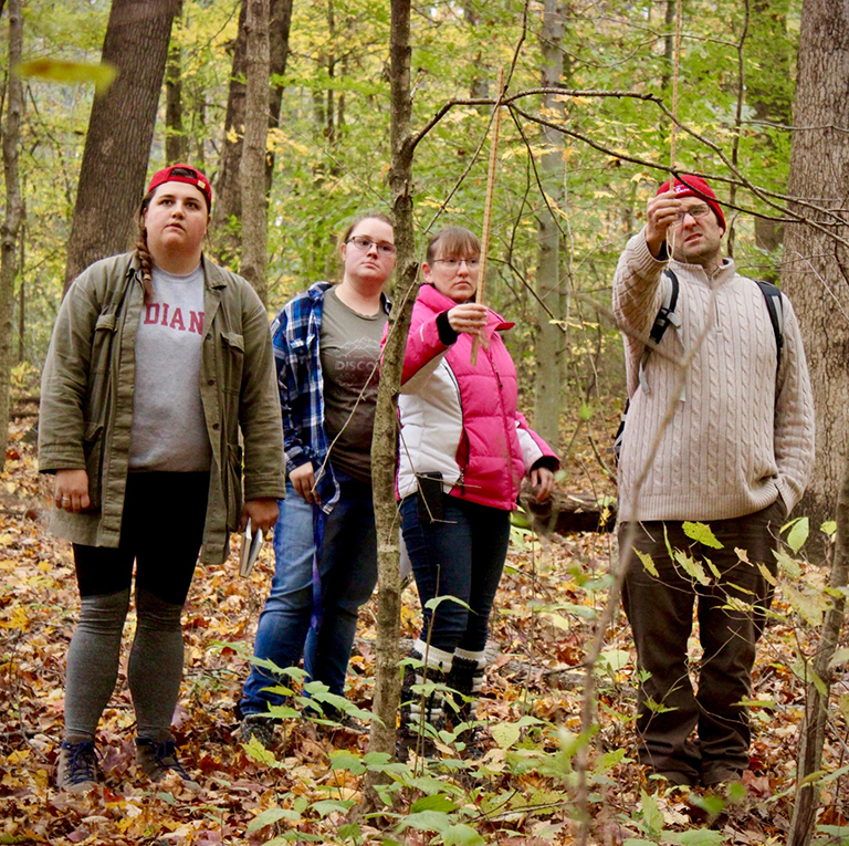 IU Students explore woods in Lawrence County, Indiana.